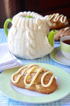 Tender, fragrantly spiced apple cinnamon scones with chunks of sweet apples and a drizzle of vanilla cream cheese glaze. Ideal for a Fall weekend brunch... and are you lovin' my wife's teapot sweater or what?
