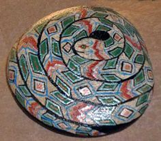 Painted rocks by artist Cindy Thomas