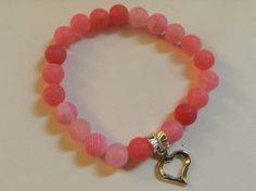 Pink beaded Stretch bracelet with Heart Charm by JnJGiftsnCrafts