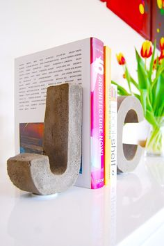 DIY Projects Made With Concrete - DIY Concrete Letter Bookends - Quick and Easy DIY Concrete Crafts - Cheap and creative countertops and ideas for floors, patio and porch decor, tables, planters, vases, frames, jewelry holder, home decor and DIY gifts. Modern, Rustic and Farmhouse Decor Ideas http://diyjoy.com/diy-projects-concrete