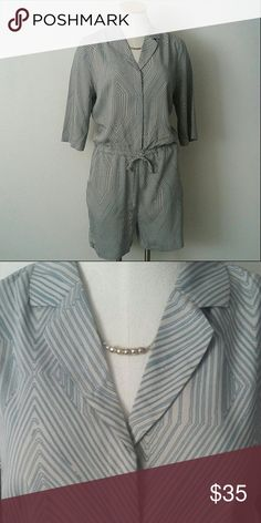 Just Female Relaxed Romper 100% cotton blue and greige distorted chevron pattern.  Relaxed fit with elastic tie at waist.  Hidden buttons on top half with v-neck collar.  Labeled XS, but my mannequin is a S/M. ASOS Other