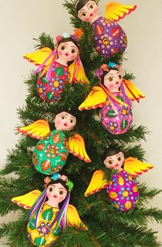 These lovely folkloric Christmas Angel ornaments are crafted entirely by hand from cardboard and paper. They are then diligently painted, paying special attention to every detail. A very colorful and. Mexican Christmas Decorations, Christmas Tree Themes, Christmas Paper, Diy Christmas Ornaments, Christmas Angels, Crochet Ornaments, Christmas Poinsettia, Crochet Snowflakes, Crochet Christmas