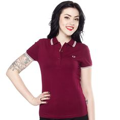 FRED PERRY GIRLS TWIN TIPPED POLO TAWNY PORT Grab this classic shirt with updated colors! This girl's Fred Perry Polo is cotton with a small amount of elastane for a snug and fitted style. This classic styled shirt has details that include a deep 3-button placket, white tipping on the collar and sleeves and the embroidered Laurel Wreath. $74.00 #fredperry #gals #polo