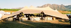 Overgaauw, a wine estate of distinction in the Stellenbosch Kloof with a stunning tent venue for weddings. caters for 50 to 150 guests.