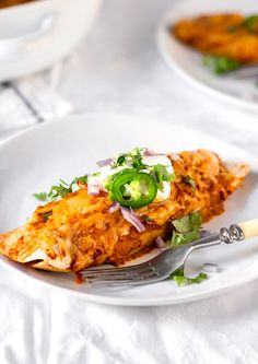 Easy and Healthy Rotisserie chicken enchiladas recipe with a simple homemade enchilada sauce. A quick and healthy alternative to takeout, and a good way to use cooked leftover chicken. This recipe is a part of my 5 Easy Recipes with leftover rotisserie chicken project.
