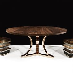 arc base dining table by Hudson Furniture