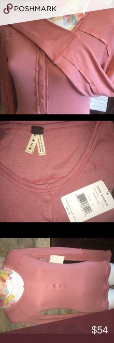 Free People NWT dusty mauve snap front shirt S Super soft and chic, this brand new with tag Free People shirt is the perfect first layer under Fall fashions. Size small with six metal snaps in front to control how much skin you want to show. This is a lovely muted mauve color, 96% rayon and 4% spandex for comfort and fit. All the Free People details are there; it is hemmed down the middle of the back and down the sleeves. Why pay retail for the latest look? Free People Tops