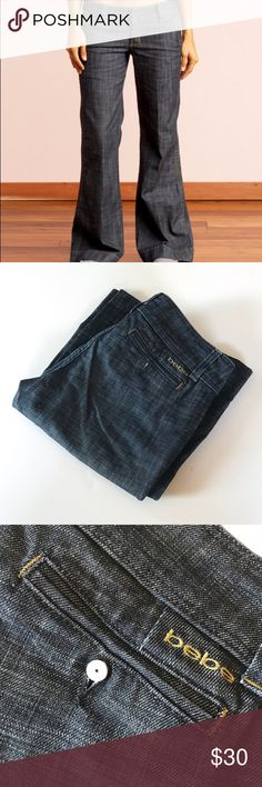 """Bebe Sexy Wide Leg Jeans These Bebe Wide leg Jeans are sexy & comfy. I have 2 pairs: size 29P (32"""" inseam) and 29 (34"""" inseam). Here are the details: high quality denim, dark blue color, a little stretchy (not much), wide leg fit, low rise, wide waist band, fitted butt (very flattering) gently worn. Photo do not do these jeans justice! Both pairs do not have the button cover on back pockets, 34"""" inseam pair has some fraying on bottom of jeans from dragging (see photos). Bundle 2 or more…"""