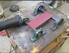 Notcher Grinder Homemade notcher grinder constructed from pillow bearings, shafting, a sanding belt, and an angle grinder