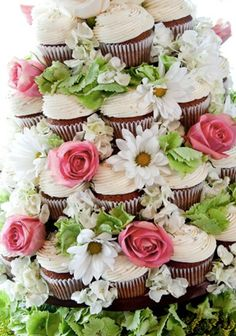 cupcake wedding cake, first cupcake cake that I have really liked, so cute, probably a lot less expensive than a wedding cake from a shop.Plus I could do vanilla, chocolate and red velvet so people could get what they want.