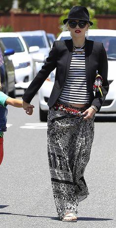 Striped top, black blazer, patterned skirt, sandals, lipstick.