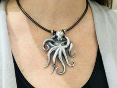 Octopus pendant in silver on  leather cord