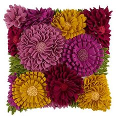 The bright appliquéd flowers adorning this delicate Floral Felt Pillow add a nice splash of color to any room.