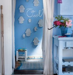 Love the color, the stenciled typography but in particular, the patterned baseboard. Paris apartment with Moroccan style!