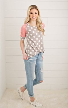 Polka dots and lace, why not?!? You simply can't go wrong with this top. Dress it up or dress it down but either way you are sure to look fabulous!