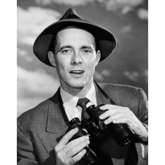 Portrait of young man holding binoculars Canvas Art - (24 x 36)