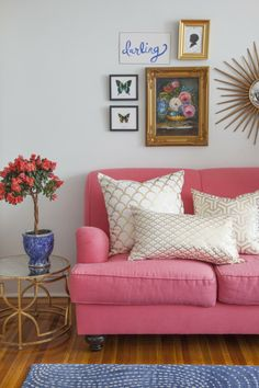 caitlin wilson textiles gold hong kong collection= pink couch and gold chevron pillows