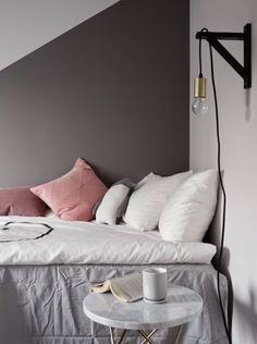Cute pink pastel and white bedding, lamp, marble bedside table