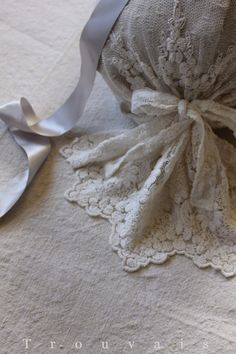 Love this idea to use vintage lace to wrap a pillow and not have to cut and sew  or harm the lace!  Bella Notte Linens on Trouvais