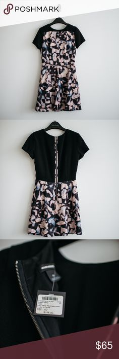 """Club Monaco Charis Print Dress w/ tag Excellent condition. With tag. Price is final.   Product details:  """"With a bold print, the classic silhouette gets an edgy update with an exposed zip and unique pattern blocking. A-line silhouette. Rounded neckline. Allover print with contrast yoke. Short sleeved.""""  - Slash pockets at skirt. Exposed zip at back. - Falls 32"""" from high point of the shoulder.  - Fits true to size.  - Fully lined. Polyester blend.  - Dry clean only.  - Shell 98% Polyester 2%…"""