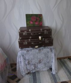 Old suitcases and painting; peonies