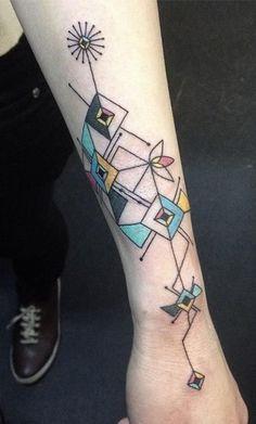 Coloured geometric tattoo by Emrah Özhan | Tattoomagz.com