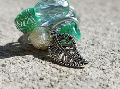 Check out this item in my Etsy shop https://www.etsy.com/listing/519512373/steel-ring-beads-leaf-charm-unique