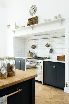 The perfect pair; an Smeg 'Opera' range cooker in stainless steel and beautiful Shaker cabinets in Pantry Blue by deVOL: