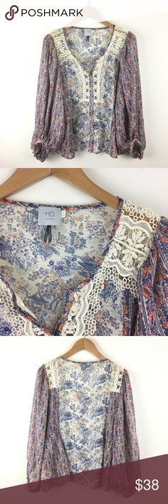 HD Paris Printed Peasanr Blouse with Crochet Gorgeous floral and Asian scenic print on this 100% polyester peasant blouse. Loose, through body and sleeve. Button on cuffs. Crochet detailing on shoulder and chest. Button Popover style. EUC Anthropologie Tops Blouses
