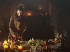 Claire mixing herbs from Outlander Community Page