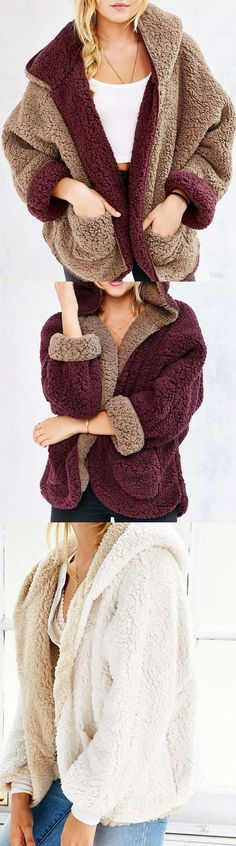 Very warm faux fur coat. It's perfect for the coming winter and it is also reversible. Two color to choose from, you can find the one you most like.