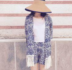 ensemble with kimono and shorts.