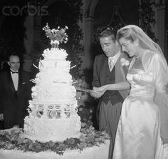 Patricia Kennedy and Peter Lawford cut their wedding cake on their wedding day, April 24, 1954 in New York.