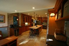 Open Concept Kitchen, Large Kitchen Island, Breakfast Nook, Large tile floor, china hutch, bead board ceiling, Copper farmers sink