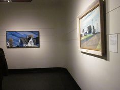 """At Swope Art Museum in Terre Haute, IN. The Swope's exhibition """"Light and Shadow: Paintings and Drawings by Philip Koch from Edward Hopper's Studio"""" is on display until Mar. 25, 2017. Included in the show is Edward Hopper's famous oil """"Route 6, Eastham"""" hanging at right. At left is the painting Koch made working from the same house Hopper painted """" Morning at the Route 6, Eastham House"""", oil on canvas, 30 x 60 inches, 2016."""