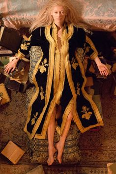 "Only Lovers Left Alive | As one half of a century-old vampire couple, Tilda Swinton's Eve's eclectic wardrobe defies categorization. ""We wanted to show that they are not contemporary, and are also not ancient"", costume designer Bina Daigeler told The Cut. From embellished caftans made by Daigeler to minimalist jackets and trousers — as well as leather gloves worn as a from of protection — Eve manages to look pulled-together despite her wild mane of long blond hair."