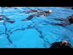 Complete with cammies and gear, Marines take swimming to a whole new level.