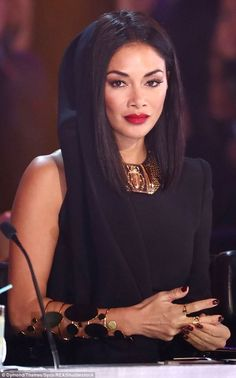 Oh dear: Nicole failed to impress with her 'hideous' outfit on Sunday night, as she donned a hooded one-sleeve black dress for the explosive semi-final
