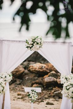 Gazebo with white roses and orchids