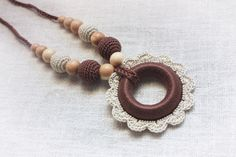 Babywearing Teething Nursing necklace for Mom with Crochet Pendant Wooden Ring flower Teether - Breastfeeding jewelry - cream purple brown by NecklacesForMommy on Etsy https://www.etsy.com/se-en/listing/117745555/babywearing-teething-nursing-necklace