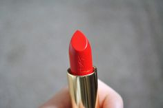 If I ever get the guts to splurge on a perfect lipstick--this orange/red YSL would be it