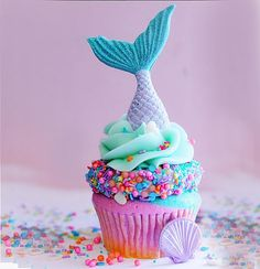 Mermaid Citrus flavored sour blue raspeberry tie-dye cupcake, filled with a sour blue raspberry jelly, sour blue raspberry buttercream, mermaid sprinkles, and a chocolate mermaid tail.Flavors of the Month at The Cake Mamas   Glendora, CA