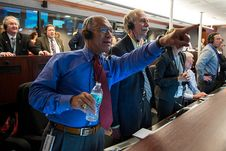 NASA Administrator Charles Bolden and William Gerstenmaier, Associate Administrator for NASA's Human Exploration and Operations Directorate, and others in Building AE at Cape Canaveral Air Force Station in Florida monitor the Orion spacecraft as it returns to Earth and splashes down in the Pacific Ocean.