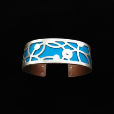 Handmade from sterling silver and anodized aluminum. #ilovegogojewelry #cropcircles #cuff