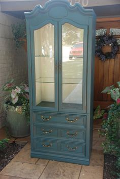 """Thomasville China Cabinet with Annie Sloan """"Aubusson Blue"""" lightly distressed with clear and dark wax. Inside """"Old White"""" with clear Wax. Lighted with two glass shelves and three drawers. 32"""" X 18"""" X 80"""". $350"""