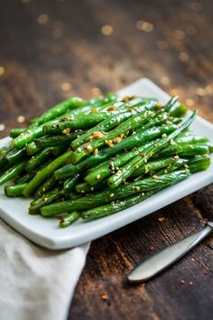 These Sesame Ginger Glazed Green Beans are a great side dish for a lot of Asian inspired main dishes, but they're also absolutely perfect for my Slow Cooker Chinese 5 Spice Pulled Pork. They're quick and easy to make, dairy free, gluten free, and paleo. Vegetarian Side Dishes, Healthy Side Dishes, Vegetable Side Dishes, Vegetable Recipes, Paleo Recipes, Cooking Recipes, Ginger Green Beans, Gluten Free Soy Sauce, Veggie Tales