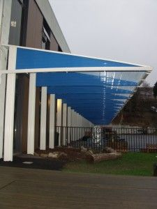 123v School canopies fitted in uk. This 50m long one is cantilevered on posts. The site is over 1150 ft above sea lever. Has been built to withstand storm force winds and snow loadings. #schoolcanopies #stormwinds