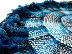Spiral Sashay Shawlette - I have no idea how you'd wear this, but it's a different way to use the sashay yarn