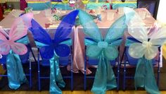 Fairy Princess Party ~ So Pretty!!  Satin fabric sash tied around the chair and butterfly wings (pick up the wings on sale right after Halloween).