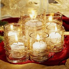 centerpiece with a cluster of different sizes of pillar candles or scatter votives across the table and window sills